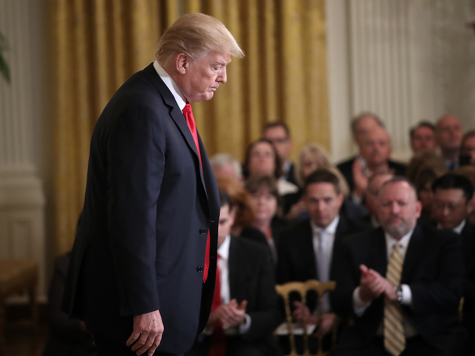 President Donald Trump departs after speaking at the White House's Opioid Summit Thursday. Trump delivered brief remarks at the conclusion of the summit aimed at addressing the opioid addiction problems in the U.S. (Win McNamee/Getty Images)