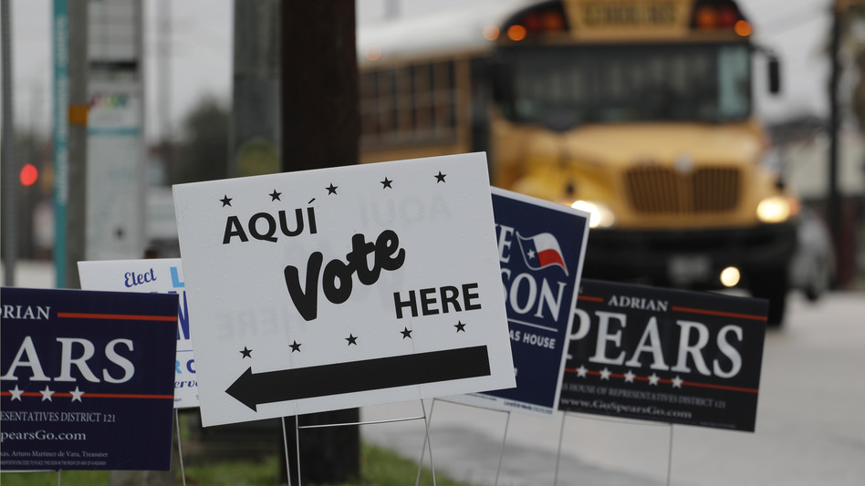 Signs mark a polling site as early voting begins began on Feb. 20 in San Antonio. Early voting in Texas ran through last Friday, March 2. (Eric Gay/AP)