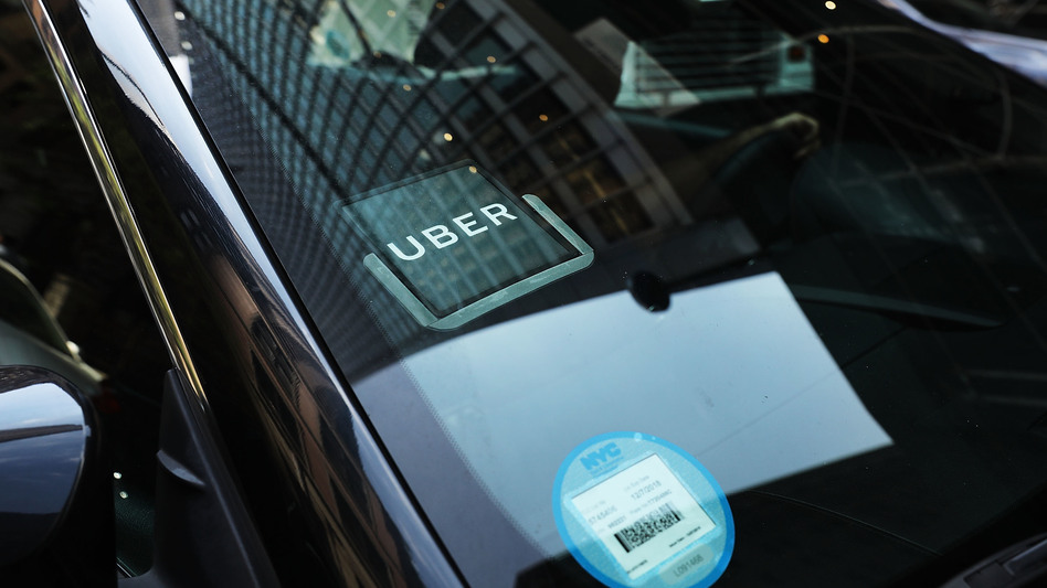 An Uber car waits for a client in Manhattan in June 2017. A study from MIT says most drivers are making less than minimum wage. (Spencer Platt/Getty Images)