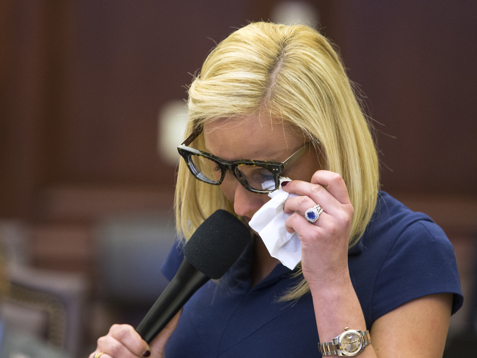 Florida Sen. Lauren Book wipes her eyes during the debate over gun control at the Capitol in Tallahassee. (Mark Wallheiser/AP)