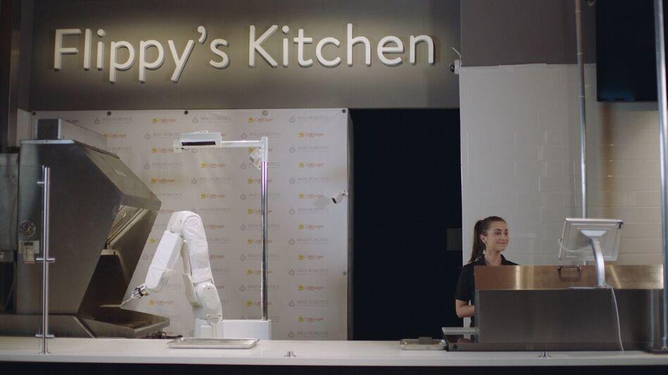 """Flippy,"" a burger-grilling robot developed by Miso Robotics, is now operating at a Caliburger in Pasadena. (Miso Robotics)"