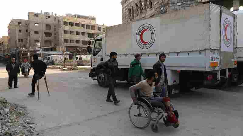 Aid Begins To Reach Besieged Syrian Region, As Civilian Deaths Continue