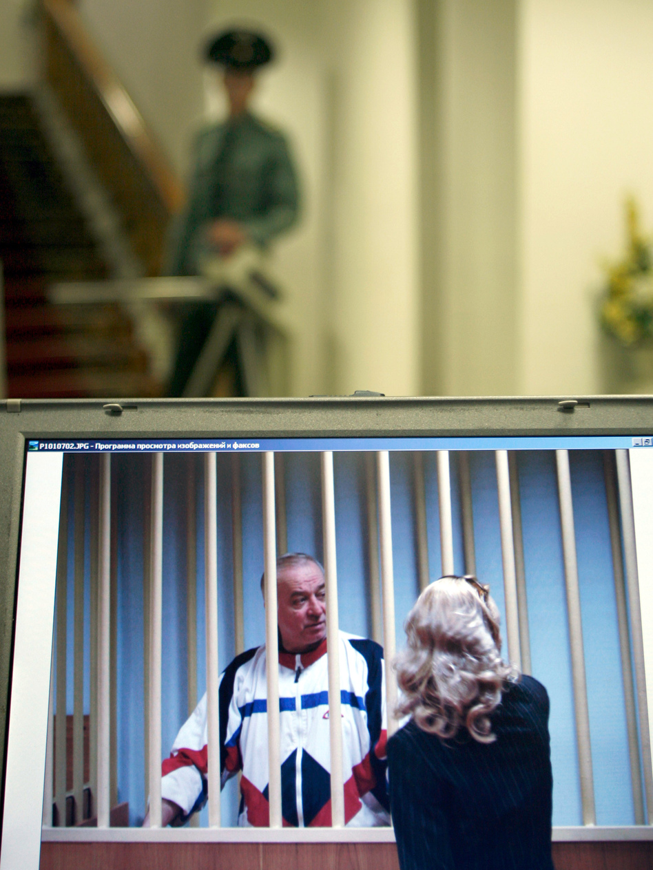 A monitor outside a courtroom shows Sergei Skripal speaking to his lawyer from behind bars in Moscow in 2006. Skripal is a retired Russian colonel recruited by British intelligence in the mid-1990s. (Misha Japaridze/AP)