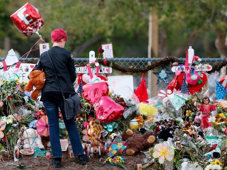 A student stops to look at a memorial at Marjory Stoneman Douglas High School in Parkland, Fla., on Feb. 28. Last month's shooting raised questions about whether states are doing enough to fund mental health services in schools. (Rhona Wise/AFP/Getty Images)