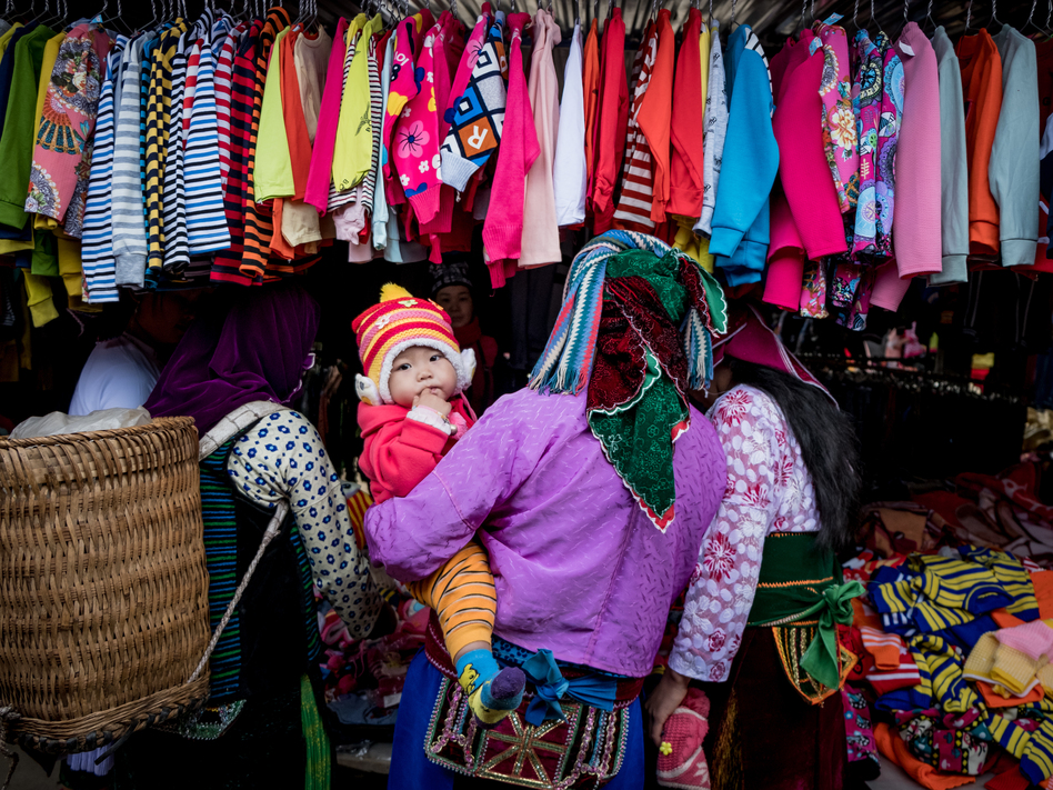 Shoppers explore the goods on display in Ha Giang, Vietnam. The country's textile industry was expected to be one of the biggest winners from the Trans-Pacific Partnership. Under the new agreement, the industry is still expected to gain — if not nearly as much.