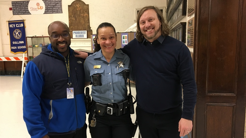 L-R: Herman Saint-Louis, an off-duty police officer, provides security during to Sullivan High School during lunch time, School Resource Officer Aricel Dunn and Principal Chad Adams.