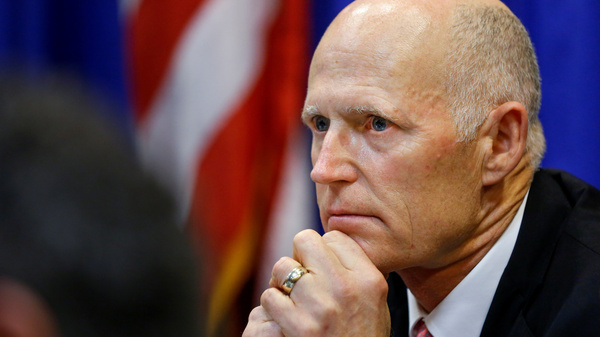Florida Gov. Rick Scott during a meeting with law enforcement, mental health, and education officials last month.