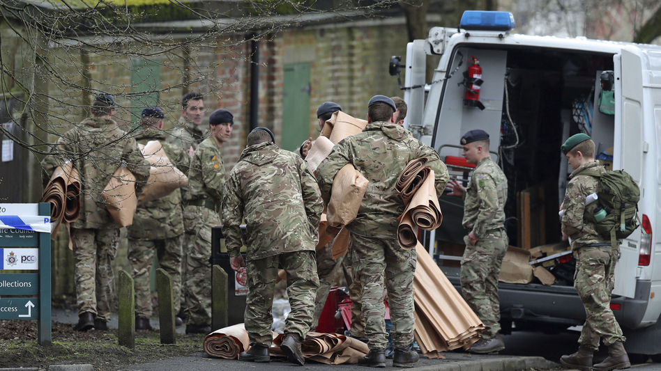 Military personnel outside Bourne Hill police station in Salisbury, England, Sunday, as police and members of the armed forces probe last week's suspected nerve agent attack on Russian double agent spy Sergei Skripal. (Andrew Matthews/AP)