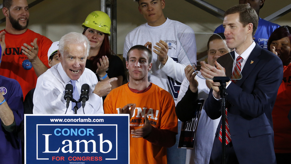 Former Vice President Joe Biden points to Conor Lamb, right, the Democratic nominee in Pennsylvania's 18th Congressional District, during a rally last week.