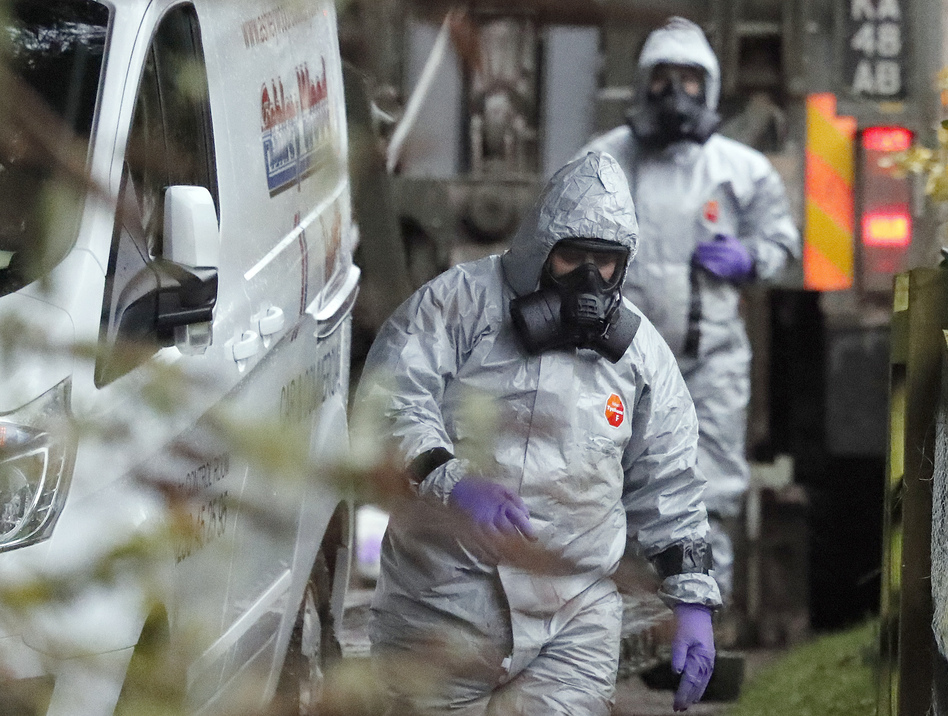 """Military forces continue investigations Monday into the nerve agent poisoning of Sergei Skripal and his daughter, Yulia. U.K. Prime Minister Theresa May says it is """"highly likely"""" that it was carried out by Russia. (Frank Augstein/AP)"""