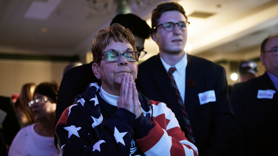 Bobbi Bauer prays during an election night event for Republican congressional candidate Rick Saccone on Tuesday. Saccone narrowly trails Democrat Conor Lamb and has not yet conceded.