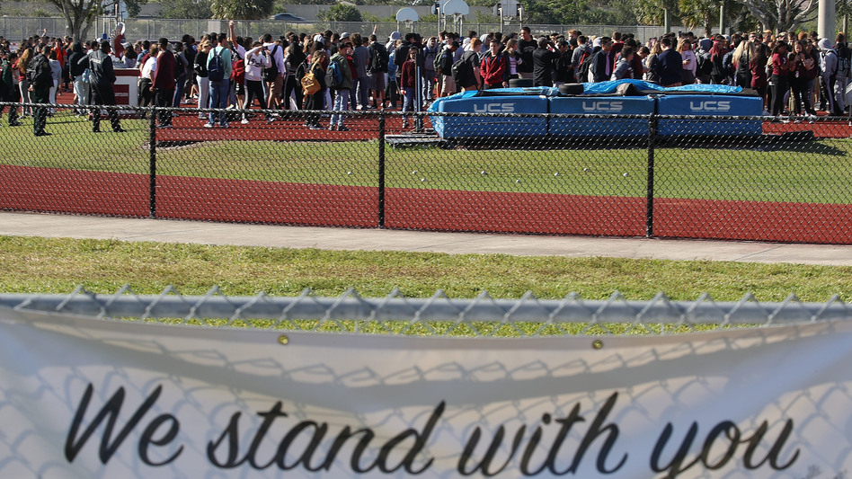 Students from Marjory Stoneman Douglas High School gather on the football field on Wednesday to honor the memories of 17 people who were killed during a mass shooting at the school in Parkland, Fla., on Feb. 14.