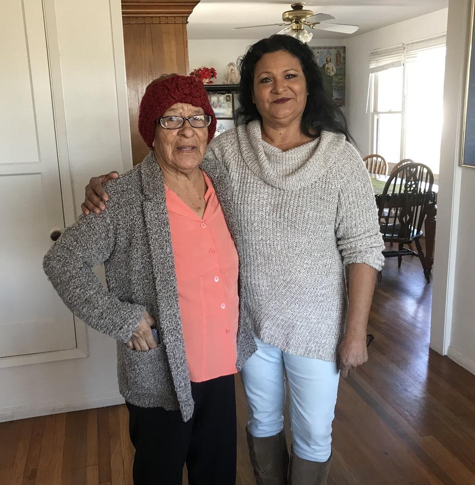 Celina Raddatz and her mother, Guadalupe Pena Villegas, at home in California. (Xavier Vasquez/NPR)
