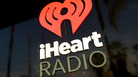 iHeartRadio logo is seen during at the iHeartRadio Theater Los Angeles on May 16, 2014 in Burbank, Calif.