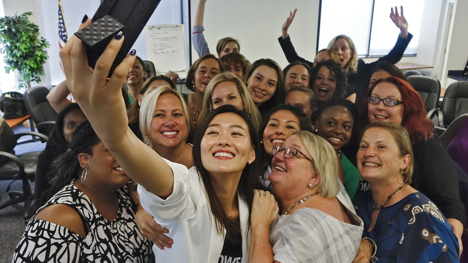 At the final session in a six-month political candidate training series called Emerge Virginia, Johanna Shin takes a group photo. (The Washington Post/Getty Images)
