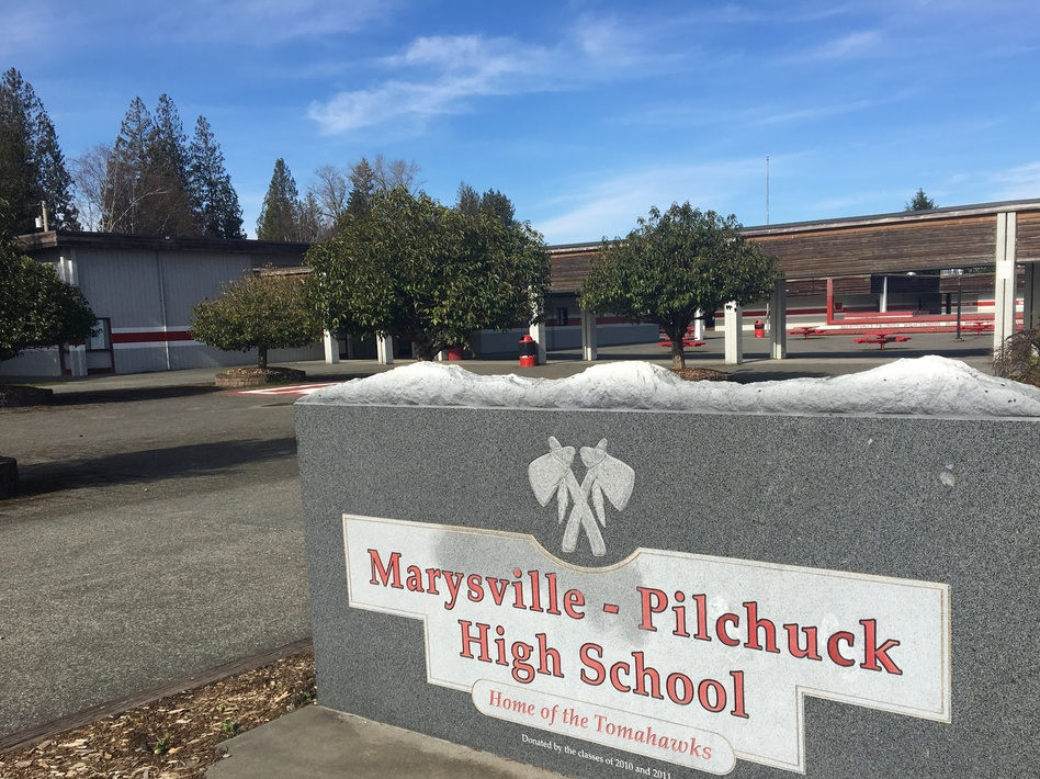 Marysville Pilchuck High School, north of Seattle. In October 2014, a freshman shot five students in the cafeteria, visible in the background. It has been locked and off-limits since the shooting. (Martin Kaste/NPR)