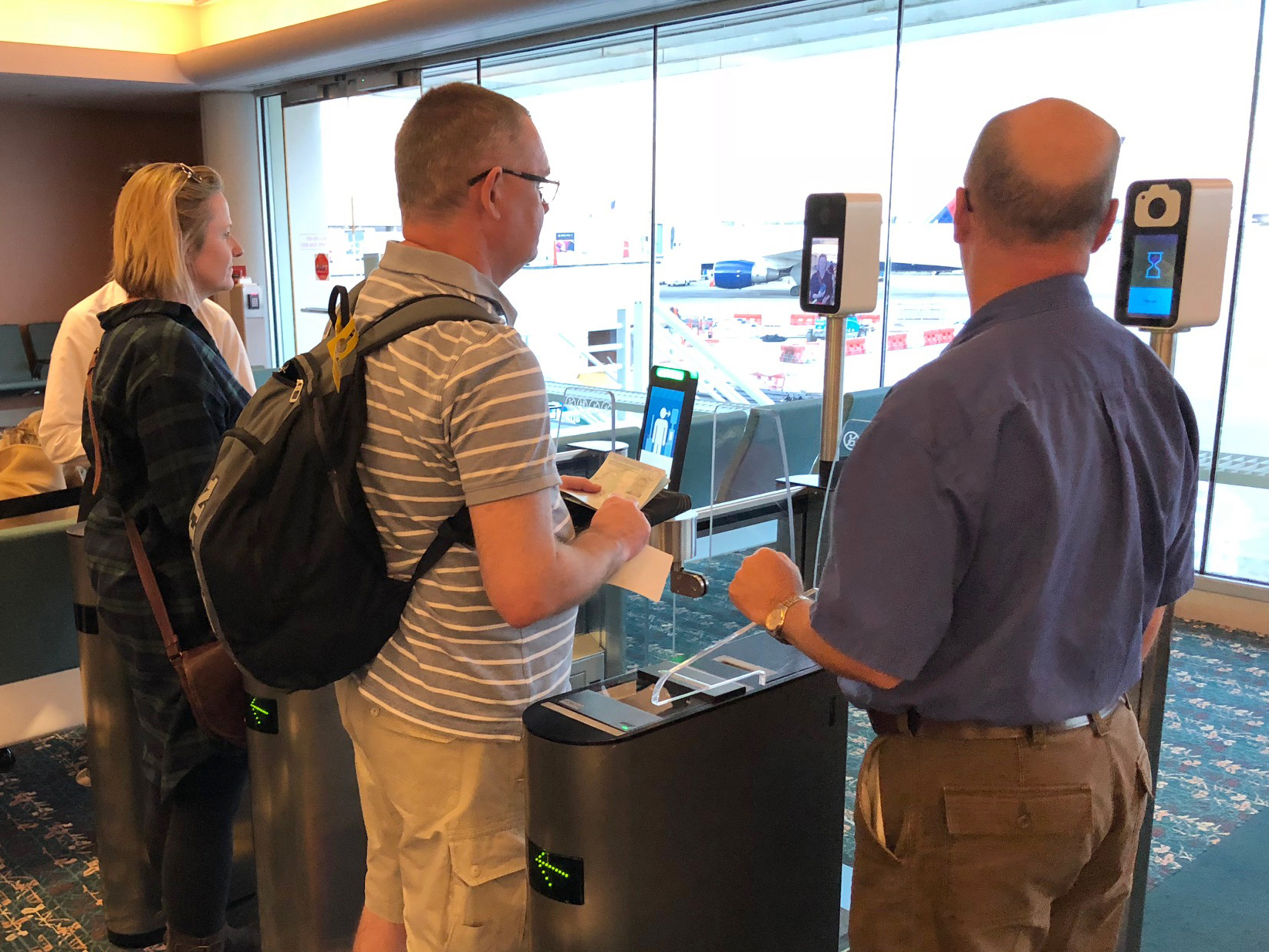 Passengers use facial recognition scanners before boarding a British Airways flight in Orlando, Fla.Customs and Border Protection is testing and hopes to expand the use of biometric scanners at airports across the U.S.Passengers use facial recognition scanners before boarding a British Airways flight in Orlando, Fla.Customs and Border Protection is testing and hopes to expand the use of biometric scanners at airports across the U.S.