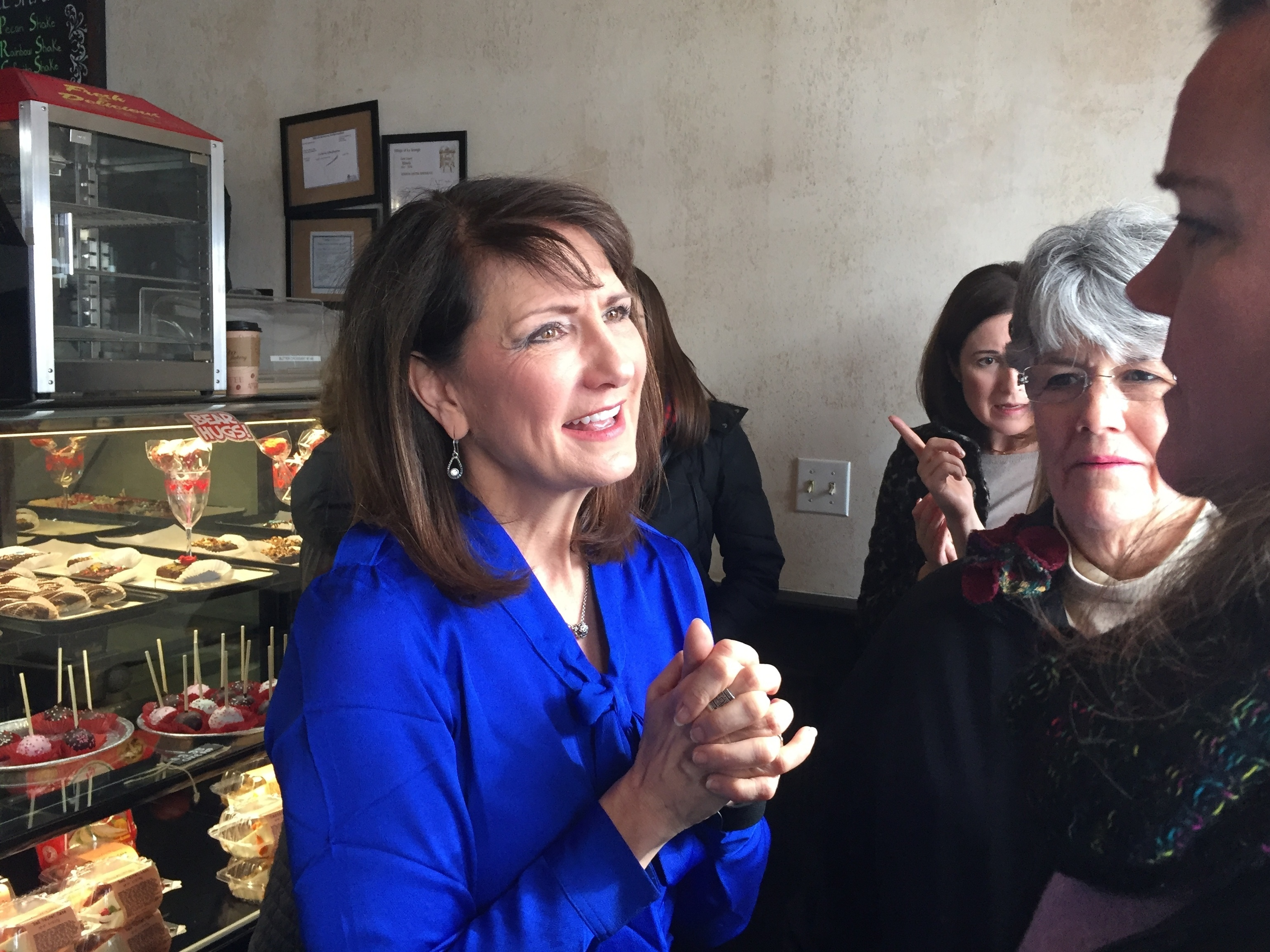 Democratic candidate Marie Newman speaks with supporters at a campaign event in Illinois's 3rd Congressional District. Newman is a political newcomer challenging Rep. Dan Lipinski in the March 20 primary. (Sara Burnett/AP)