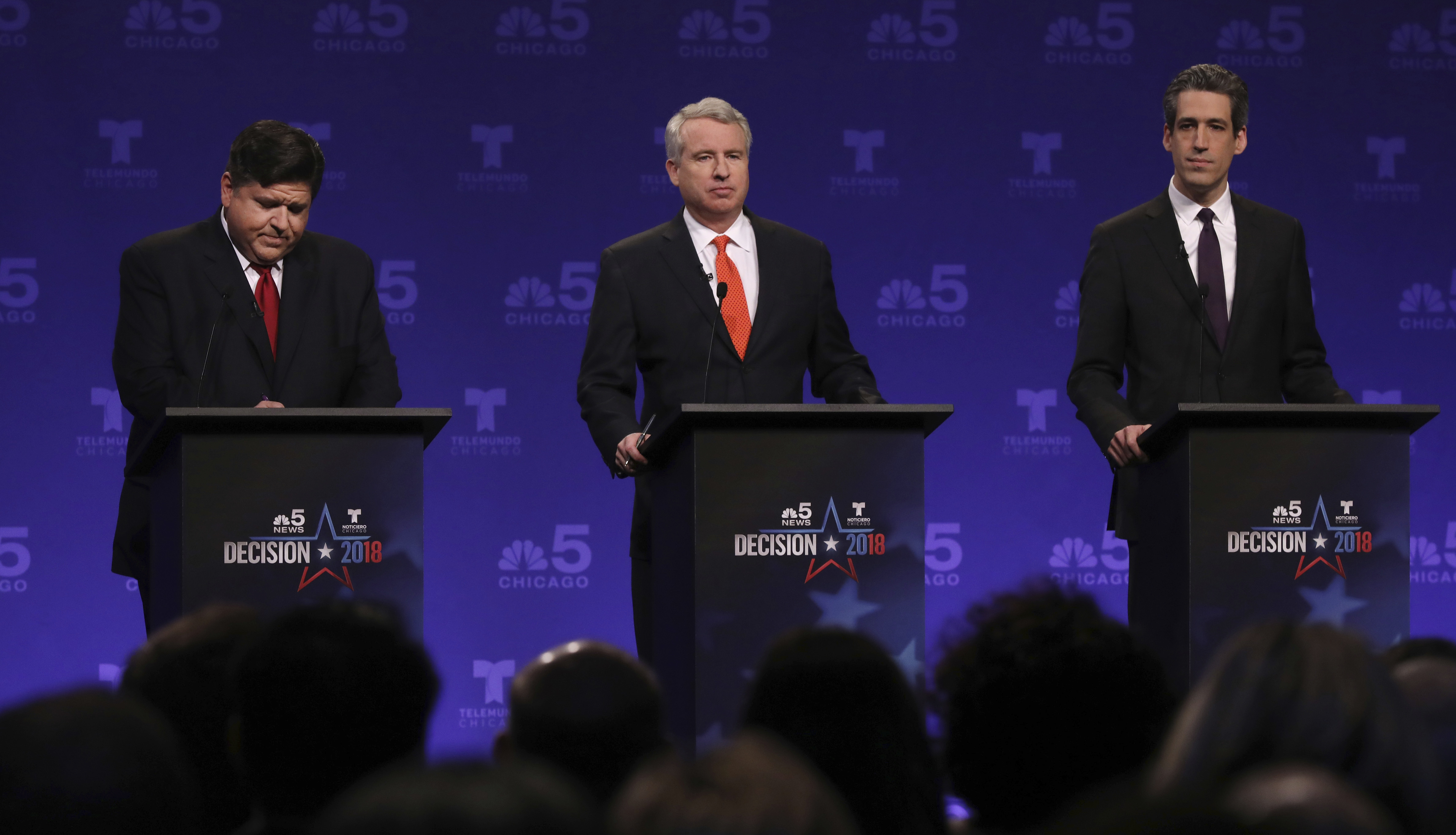 Democrats running for Illinois governor from left, billionaire J.B. Pritzker, businessman Chris Kennedy, and state Sen. Daniel Biss take their podium positions before a televised forum in January. (John J. Kim/AP)