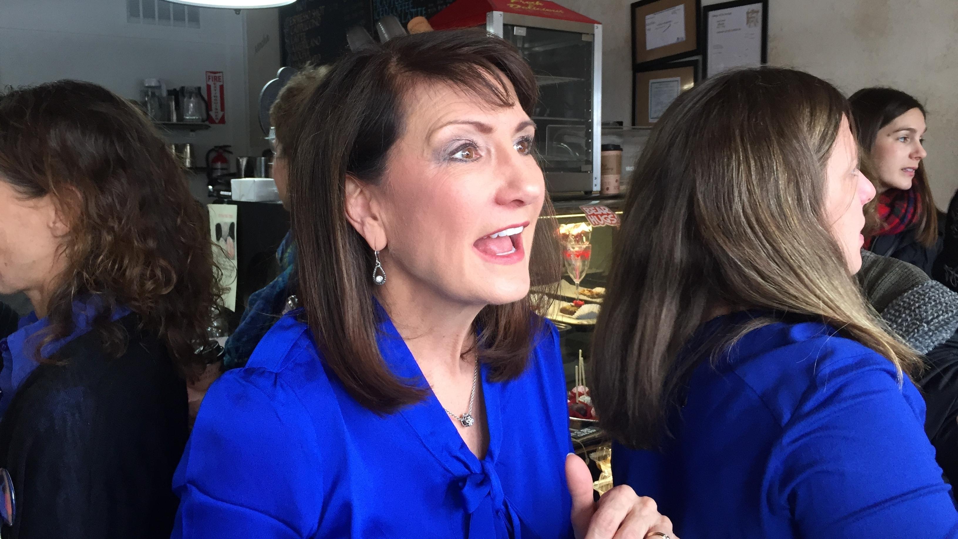 Democrat Marie Newman speaks with supporters at a campaign event in La Grange, Ill. (Sara Burnett/AP)