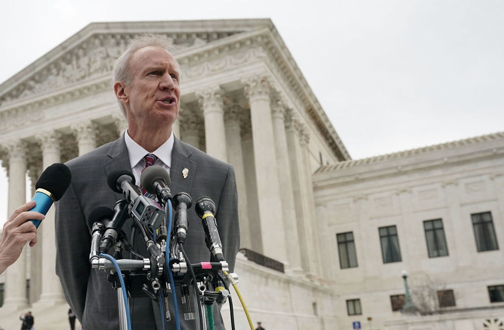 Gov. Bruce Rauner, R-Ill., speaks to members of the media in front of the U.S. Supreme Court after a hearing earlier this year. (Alex Wong/Getty Images)