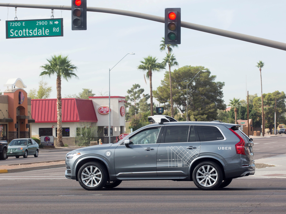 A self-driving Uber moves through an intersection in Scottsdale, Ariz., on Dec. 1, 2017. Uber on Monday suspended its self-driving tests in four cities after a pedestrian was killed by an autonomous Uber vehicle in Tempe, Ariz. (Natalie Behring/Reuters)