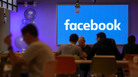 Employees have lunch at Facebook's new London headquarters Dec. 4. The social media giant is facing blowback following revelations that its user data was misused.