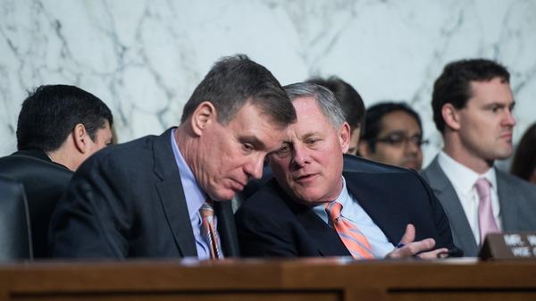 Senate Intelligence Committee Chairman Richard Burr, R-N.C. (right), and Ranking Member Mark Warner, D-Va., have released their committee