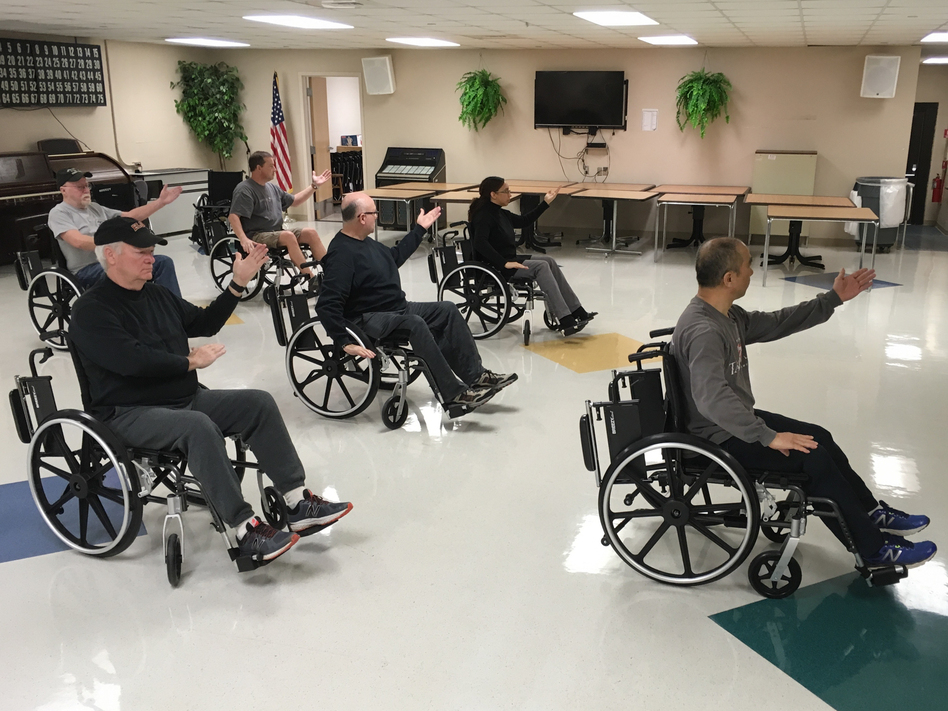 Veterans in Murfreesboro, Tenn., enjoy a wheelchair tai chi class; other alternative health programs now commonly offered at VA hospitals in the U.S. include yoga, mindfulness training and art therapy. (Blake Farmer/Nashville Public Radio)