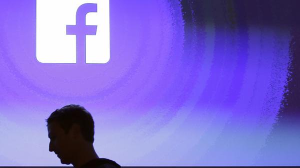 Facebook CEO Mark Zuckerberg walks at the company