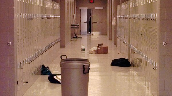 Backpacks and cleaning supplies lie in the hallway of Westside Middle School in Jonesboro, Ark., on March 25, 1998, one day after the shooting.