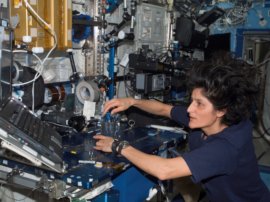 Sunita Williams conducts routine maintenance during a stint aboard the International Space Station. Nowadays, the astronaut helps Boeing and SpaceX develop private spacecraft. (NASA)