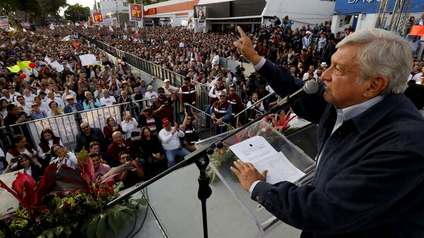 """Presidential candidate and front-runner Andres Manuel Lopez Obrador delivers a speech during a rally in Guadalajara on Feb. 11. On Wednesday, he said of  Cambridge Analytica: """"Now that it"""