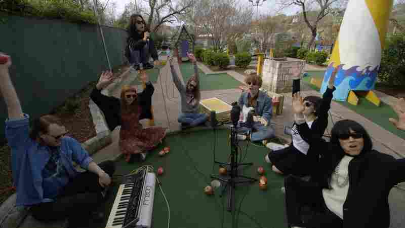 Watch Superorganism Perform 'Something For Your M.I.N.D.' At A Mini-Golf Course