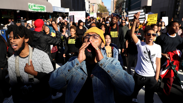 Black Lives Matter protesters march during a demonstration on Thursday in Sacramento, Calif. Protesters staged a demonstration after two officers in the city