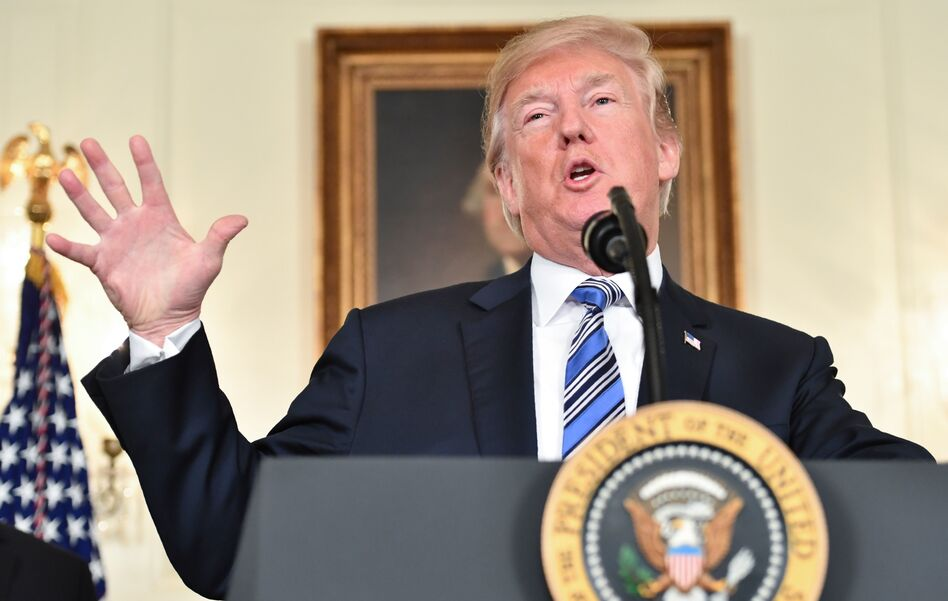 President Trump speaks about the $1.3 trillion spending bill that he signed, despite an earlier veto threat. (Nicholas Kamm/AFP/Getty Images)