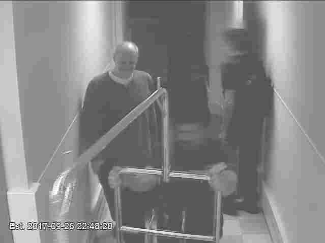Stephen Paddock smiles as a valet helps him transport luggage to his hotel room on Sept. 26.