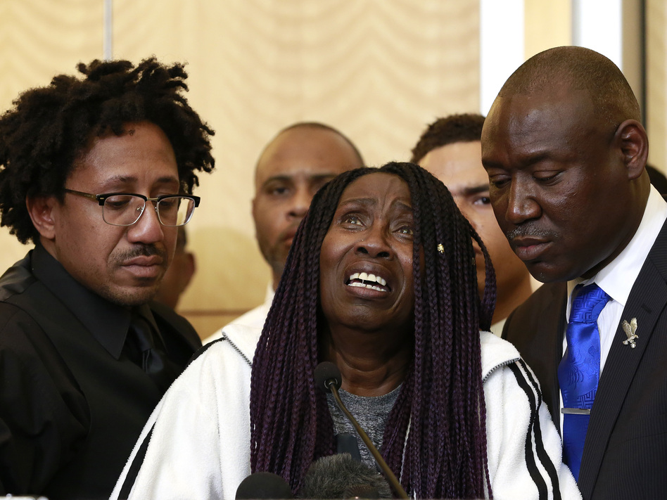 A tearful Sequita Thompson pleads for police officers who killed her unarmed grandson, Stephon Clark, to face criminal charges. Thompson was accompanied at a news conference by Clark's uncle, Kurtis Gordon (left), and attorney Ben Crump (right). (Rich Pedroncelli/AP)