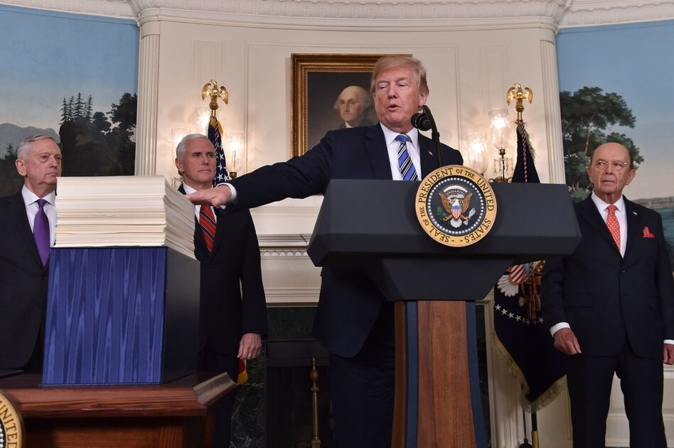 President Trump speaks about the recently passed spending bill at the White House on Friday. Trump threatened to veto the bill before later signing it. (Nicholas Kamm/AFP/Getty Images)