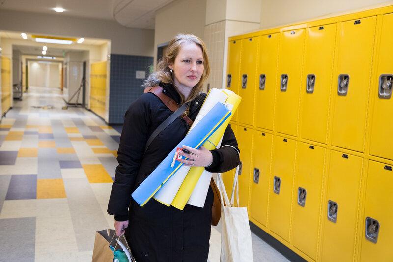 Maggie Webb, who teaches eighth-grade math, heads home from Clark Avenue School in Chelsea, Mass. (Kayana Szymczak for NPR)