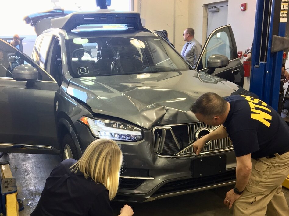 Investigators for the National Transportation Safety Board in Tempe, Ariz., examine the Uber vehicle involved in the fatal crash. (NTSB/Twitter)