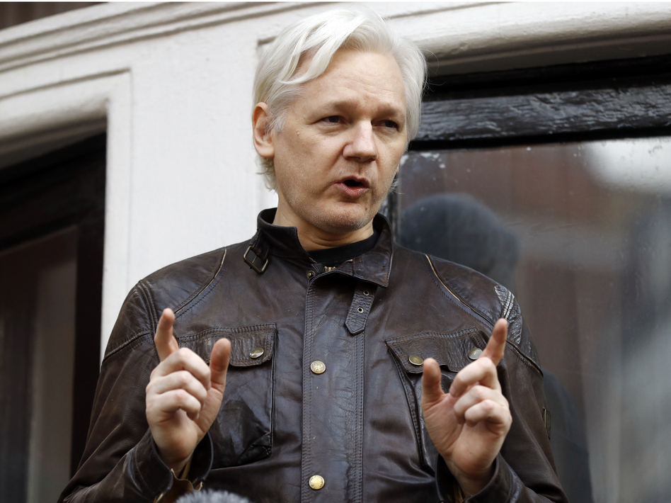 WikiLeaks founder Julian Assange talks to supporters outside the Ecuadorean Embassy in London, where he has been in self-imposed exile since 2012. (Frank Augstein/AP)