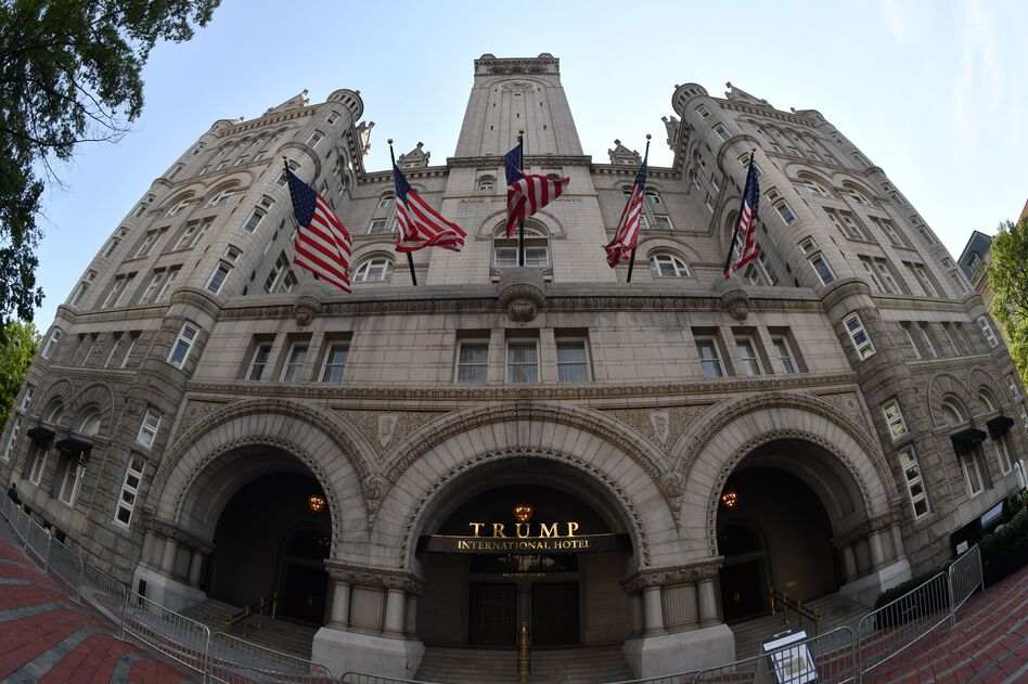 A lawsuit brought by the attorneys general of Maryland and the District of Columbia regarding President Trump's profits from the Trump International Hotel near the White House can proceed, a federal judge has ruled. (Paul J. Richards/AFP/Getty Images)