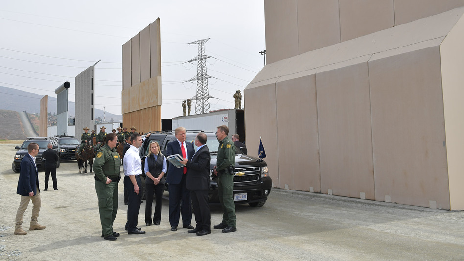 President Trump (center) is shown border wall prototypes in San Diego, Calif., on March 13, 2018. (Mandel Ngan/AFP/Getty Images)
