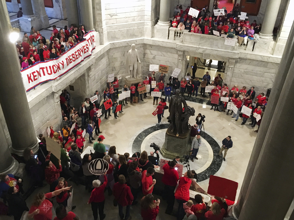 """Hundreds of Kentucky teachers protest outside Gov. Matt Bevin's office Friday in Frankfort, Ky. They crowded into the building, shouting """"Vote them out,"""" less than a day after lawmakers quickly passed a surprise overhaul of state employee retirement benefits. (Adam Beam/AP)"""