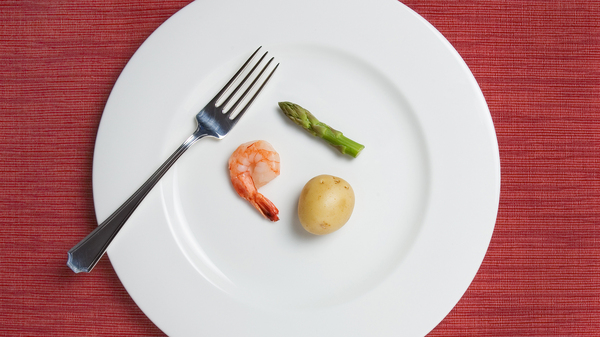 Cutting back up to 25 percent of your calories per day helps slow your metabolism and reduce free radicals that cause cell damage and aging. But would you want to?