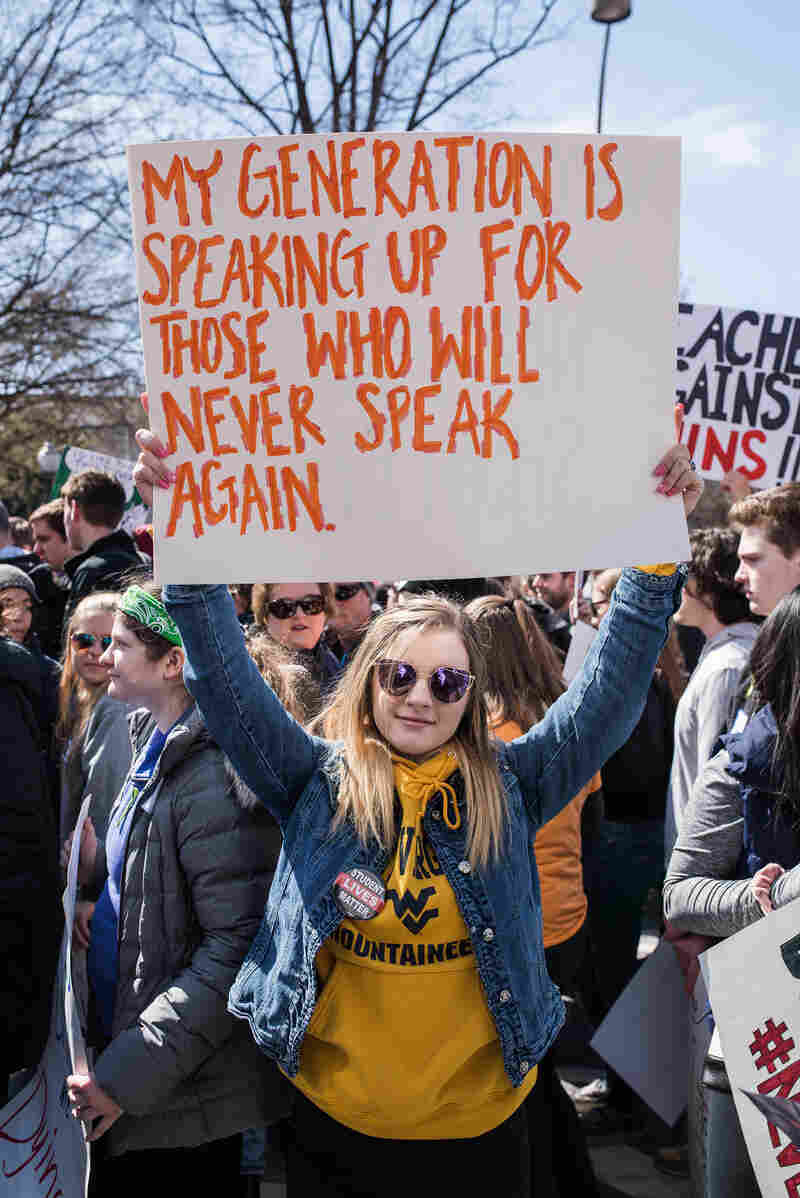 """A protester holds up a sign reading """"My Generation Is Speaking Up For Those Who Will Never Speak Again"""" at the """"March For Our Lives"""" rally in Washington, D.C. on March 24."""