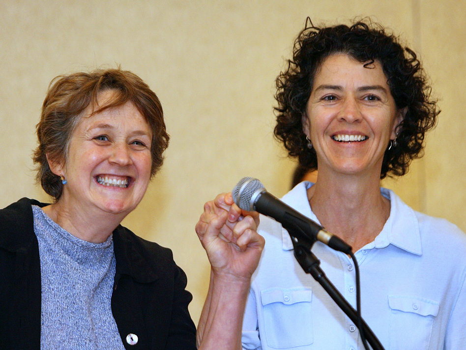 """Wendy Becker (left) and Mary Norton of Providence, R.I., raise their hands after the 2006 Massachusetts court ruling that allowed same-sex couples from Rhode Island to marry in Massachusetts. For the 2020 census, the couple can choose the new response category for """"same-sex husband/wife/spouse."""" (Boston Globe/Getty Images)"""
