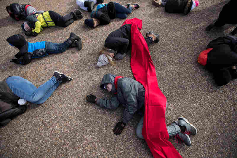 """Anti-abortion rights advocates participate in a """"die-in"""" demonstration on Pennsylvania Avenue near the White House on Jan. 27, 2017."""