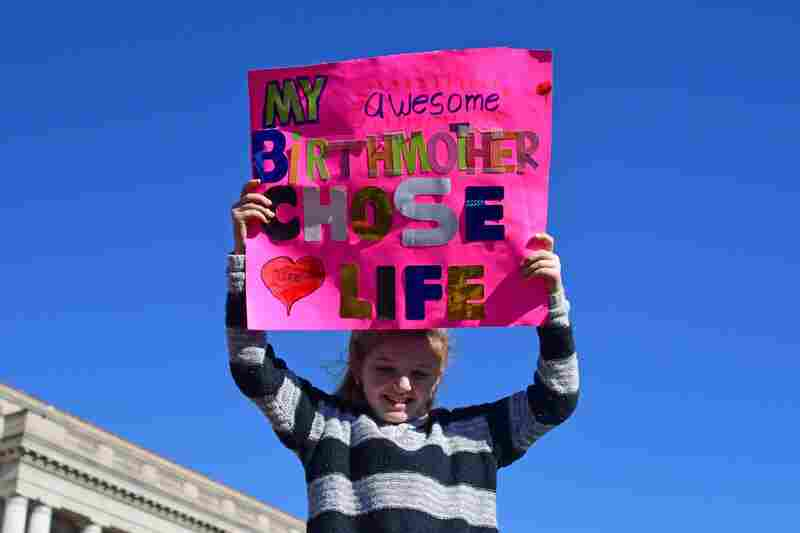 """A girl holds up a sign as anti-abortion rights activists gathered in Washington, D.C. for the annual """"March For Life"""" earlier this year."""